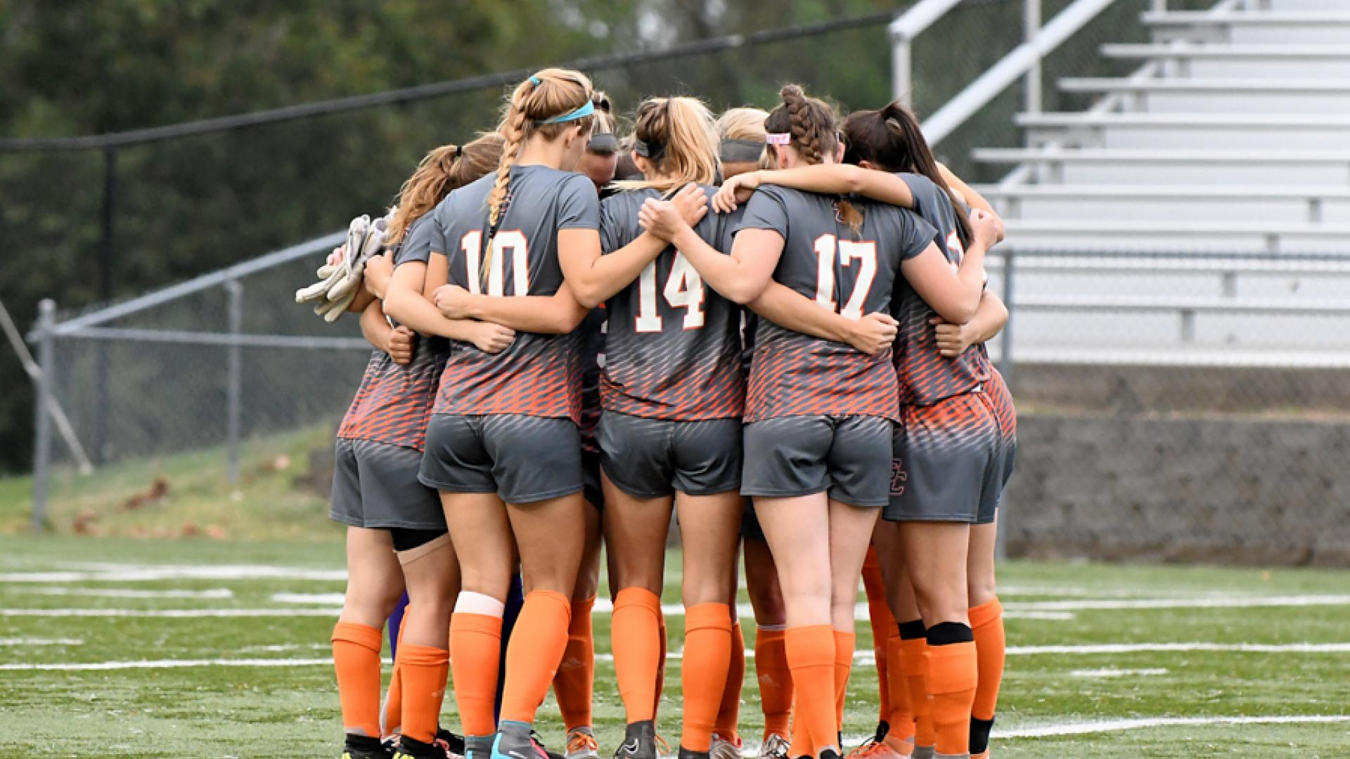 Women's Soccer Players Huddling