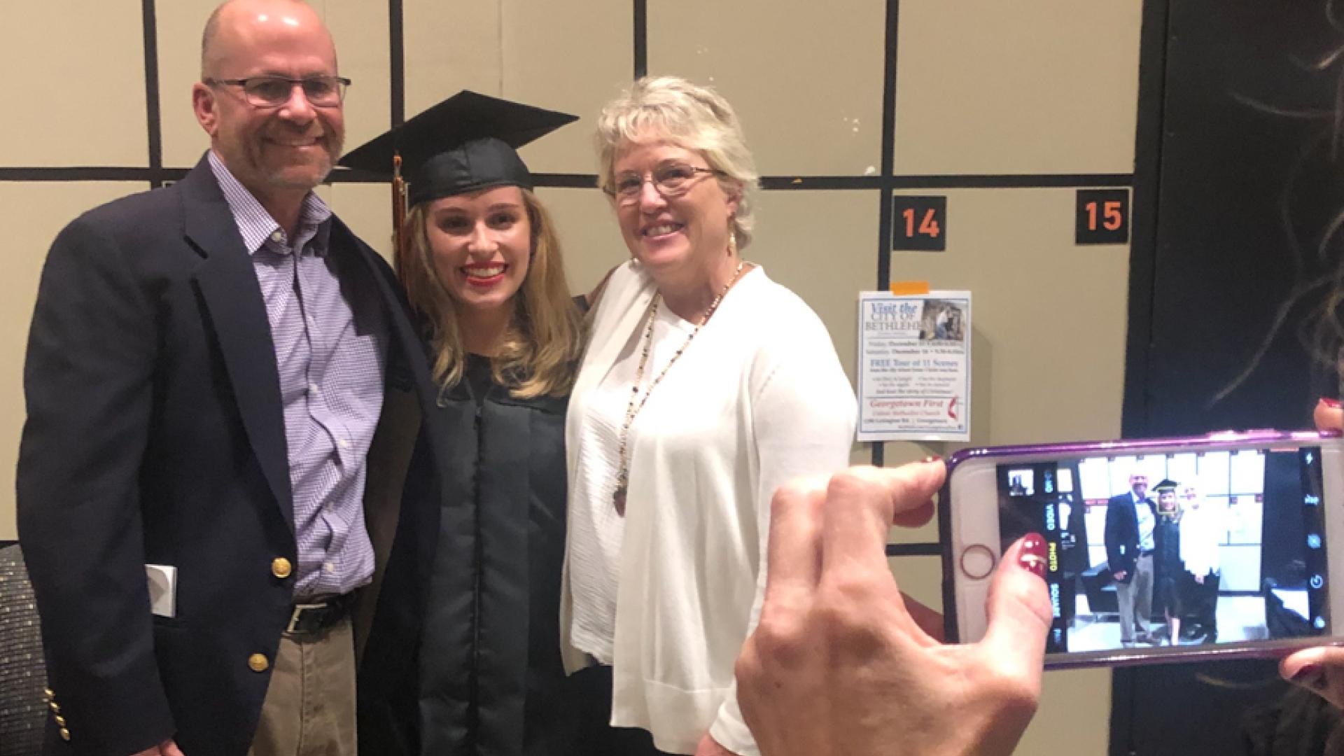 Graduate and her family pose for picture