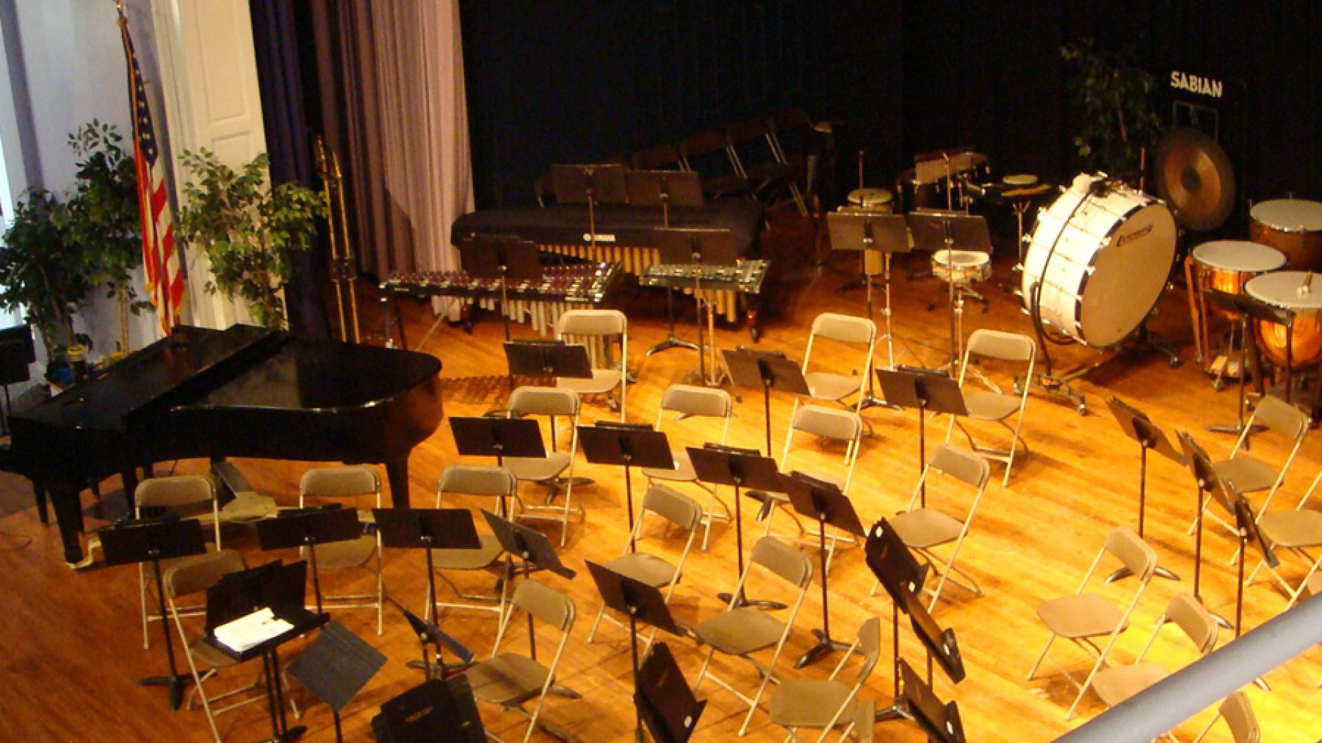 Image: Symphonic Band setup on stage of Hill Chapel