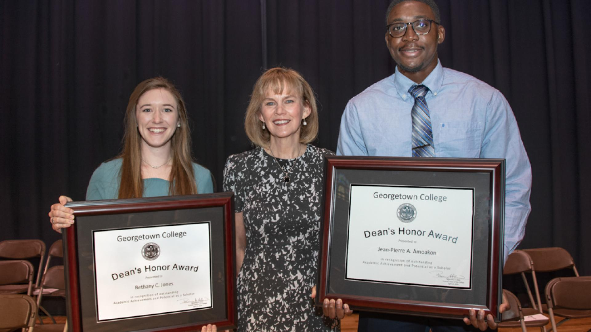 Jean-Pierre Amoakon and Bethany Jones pose with Dean's Award with Dr. Rosemary Allen.