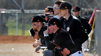 Georgetown College Baseball Team looks on from dugout.