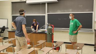 Faculty test classroom ventilation in Asher Science Center