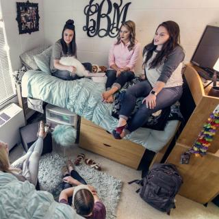 women hanging out in first year dorm
